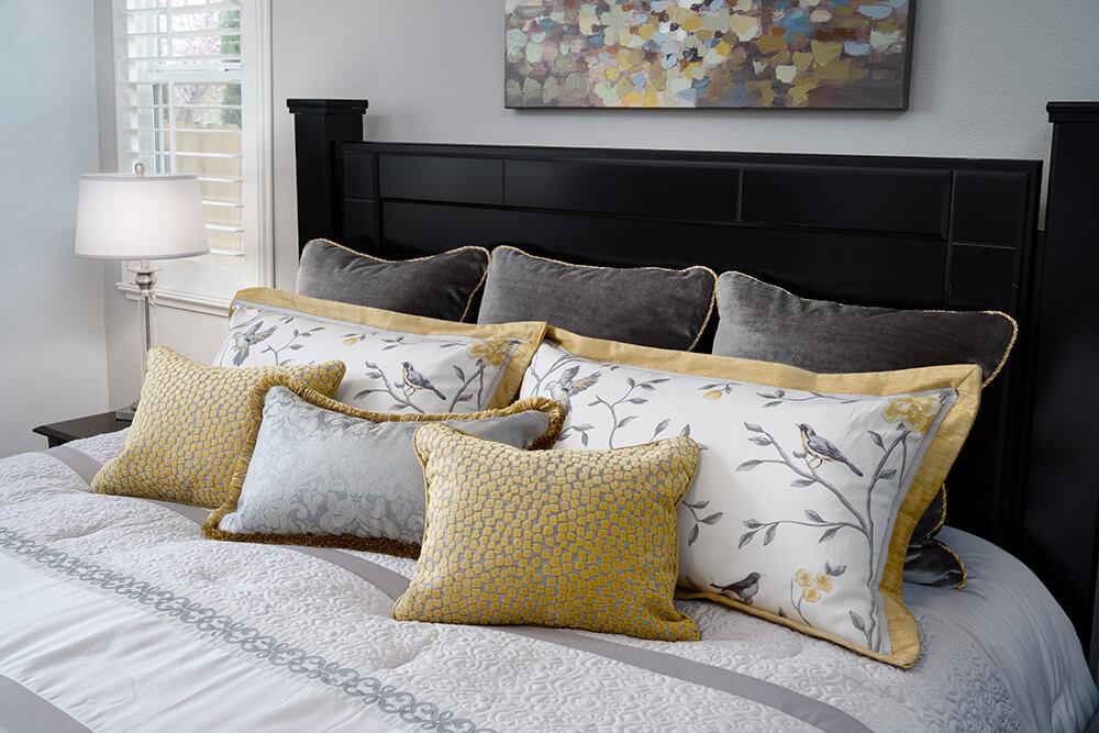 custom pillows for master bedroom using Vern Yip fabrics