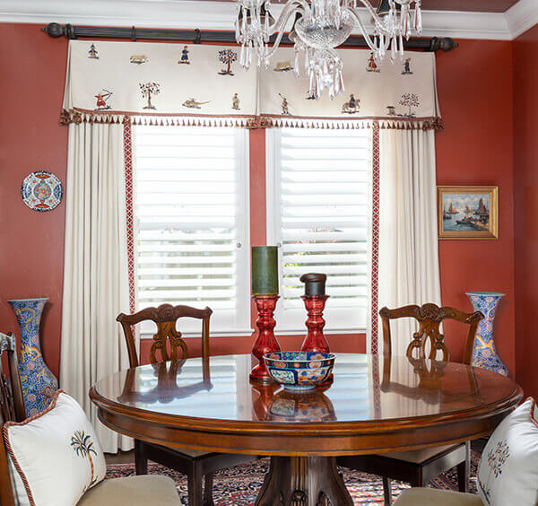 This red paint color gives this dining room a bold new look.