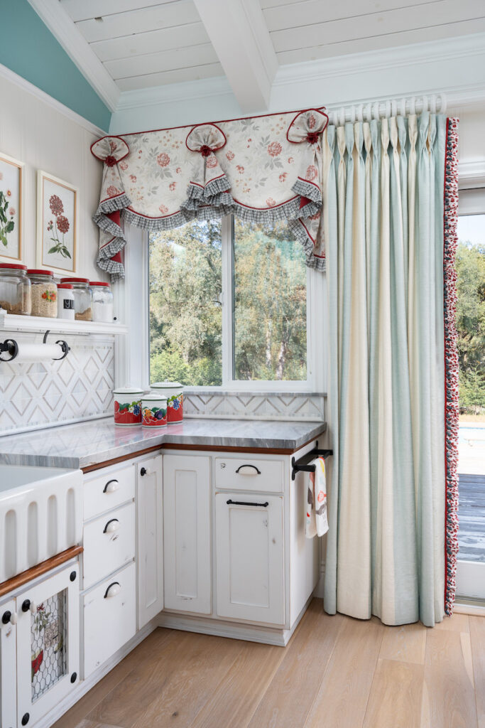 The baking center features the same fabric for a cohesive look that creates flow throughout the kitchen area